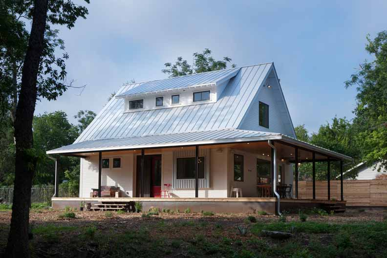 Beautiful silver roof home with steel construction porch for Farm house construction