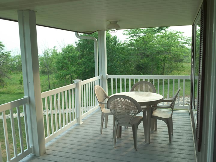 The spacious balcony with a dining set for outdoor dining on great days and stargazing.