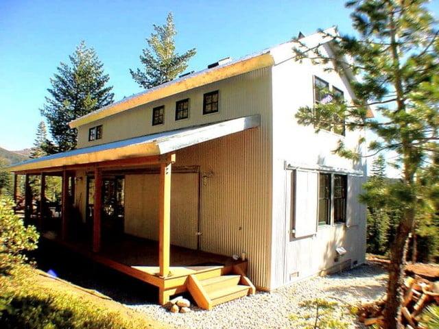 Cosy metal building cabin w wrap around porch hq plans for Metal building house with wrap around porch