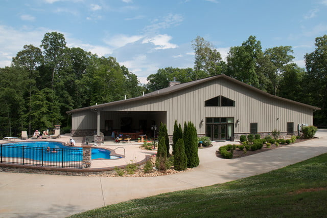 Full 42 60 metal building home w pool chill out area for Ranch style steel homes