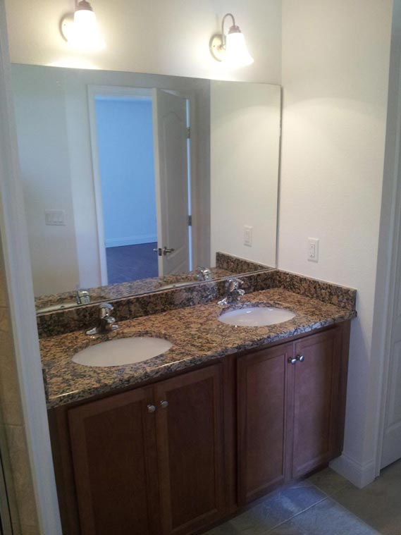 Furnished sinks and bathroom cabinets