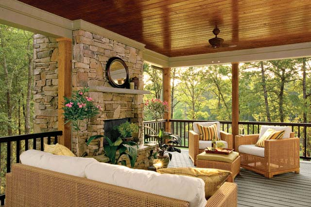 Patio with wooden fixtures and a breathtaking view of the forest.