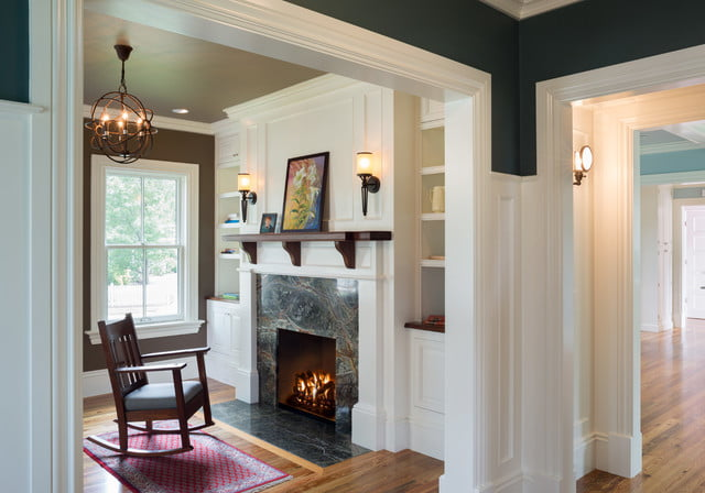 The cozy fireplace inside this stunning farmhouse
