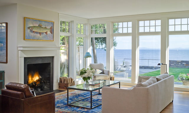 Living room with its fireplace and majestic exterior views