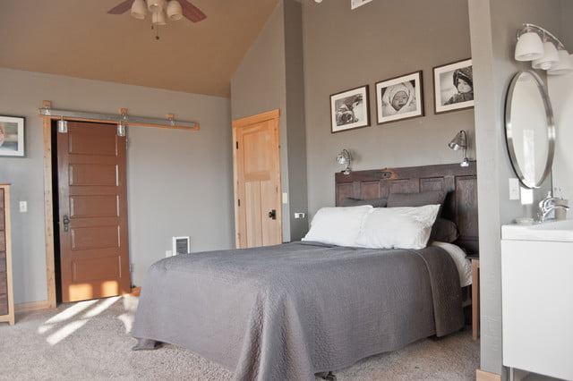 One of the three bedrooms on the second floor. Closet door is designed like a sliding barn door. This is to maximize space in an area. It has its own bathroom which is located opposite the closet area, on the left side of the bed.