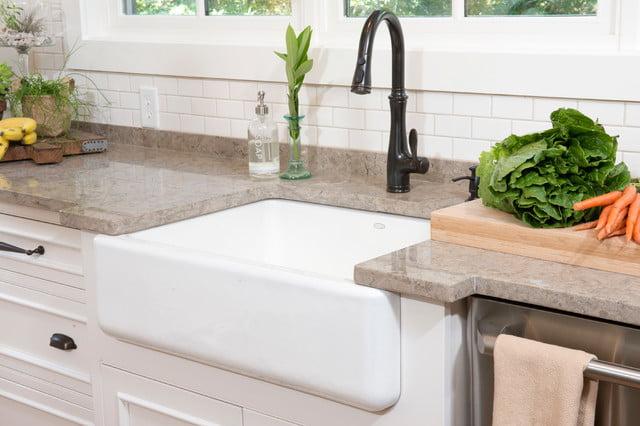 Deep kitchen sink set in granite.