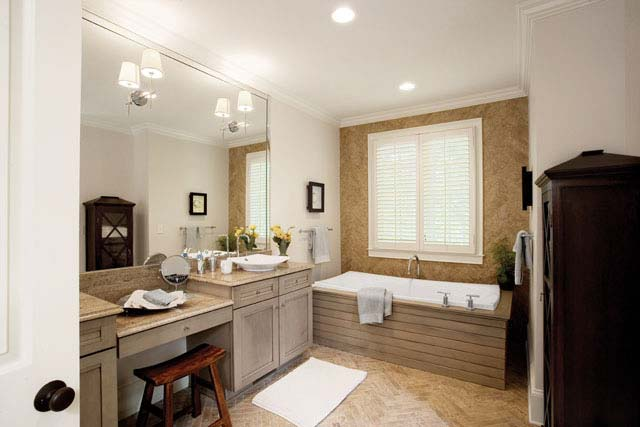 A bath tub with a wooden touch