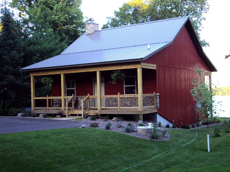 Rare cosy metal barn w porch stone fireplace hq for Metal cabin kits