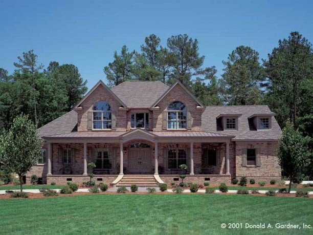 One of a kind texas style country home w brick wainscot for Brick farmhouse plans