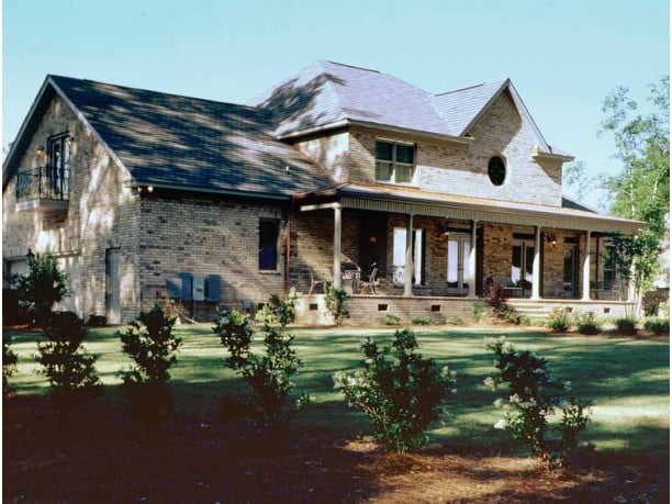 2 story metal buildings with balcony in texas hill country for Country home builders in texas