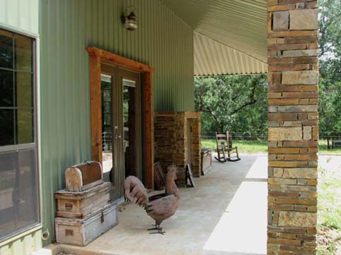A spacious porch by the entry way of the house.