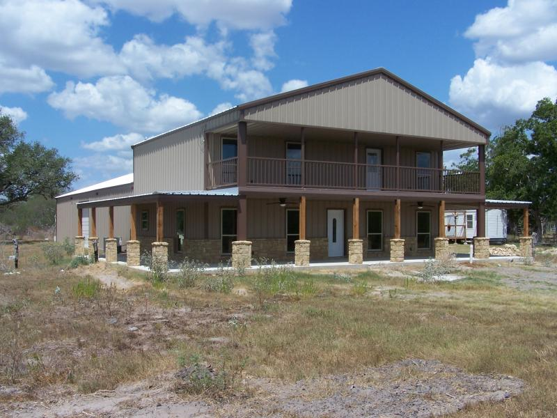 Steel frame homes w limestone exterior more 10 hq for Two story metal building homes