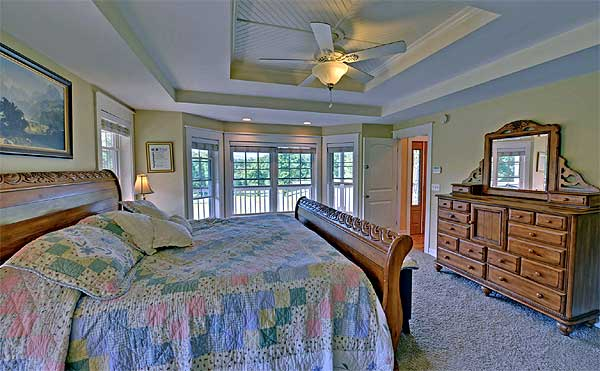 Spacious bedroom with a great view outside.