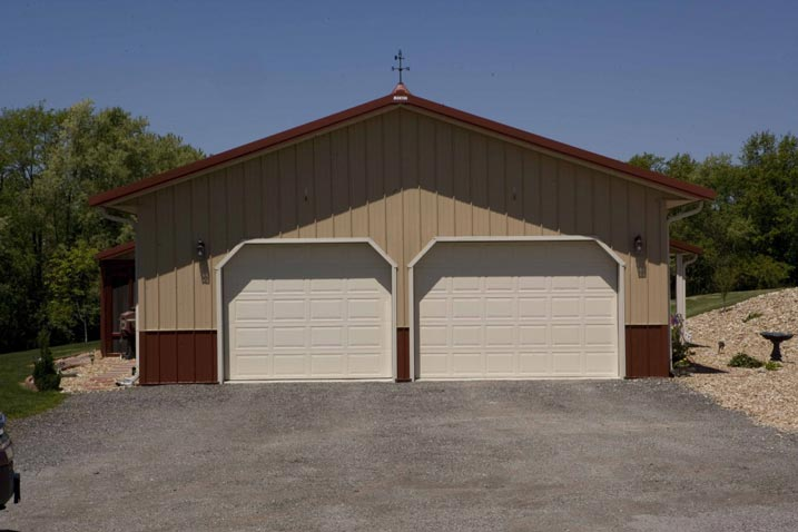 Two garage doors painted in white. Amazing how white can easily blend with beige and brown.