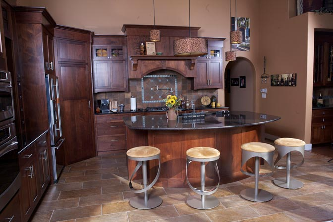 Kitchen and dining area. Stools are uniquely designed and complements the general theme of the area.