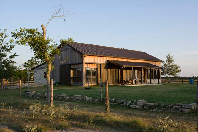 One hell of a custom metal home w wood siding hq plans for Custom pole barn homes