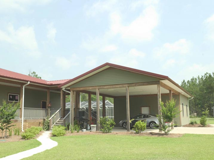 Villa type metal building home w wrap around porch hq for Metal garage with porch
