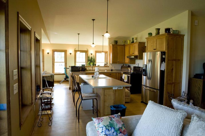 An open kitchen with dining area