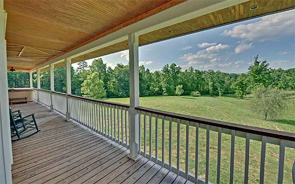 This spacious porch is the best place to unwind on sunny days and starry nights.
