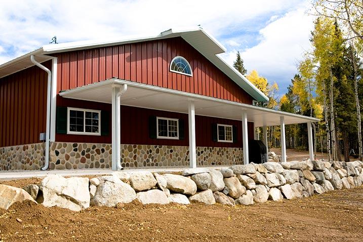Beautiful metal building w wrap around porch stone for Beautiful metal building homes