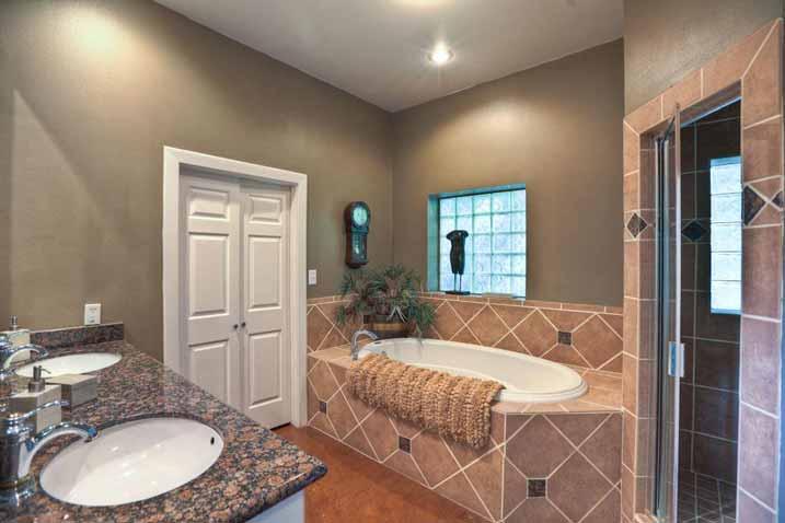 Enjoy a relaxing bath with this sleek bathroom design.