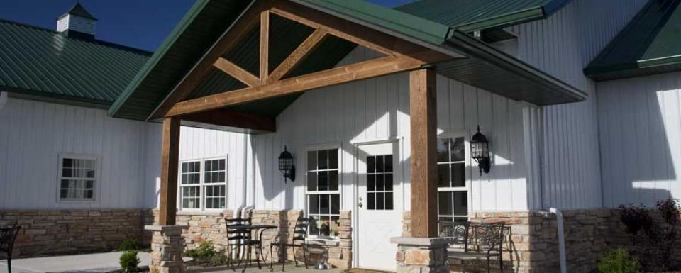 Deluxe pole barn lake house w rustic porch stone facade for Barn house plans with porches