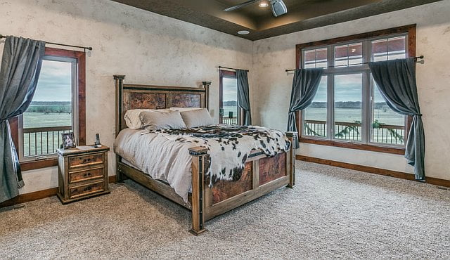 The bed room bears the feels of a countryside retreat