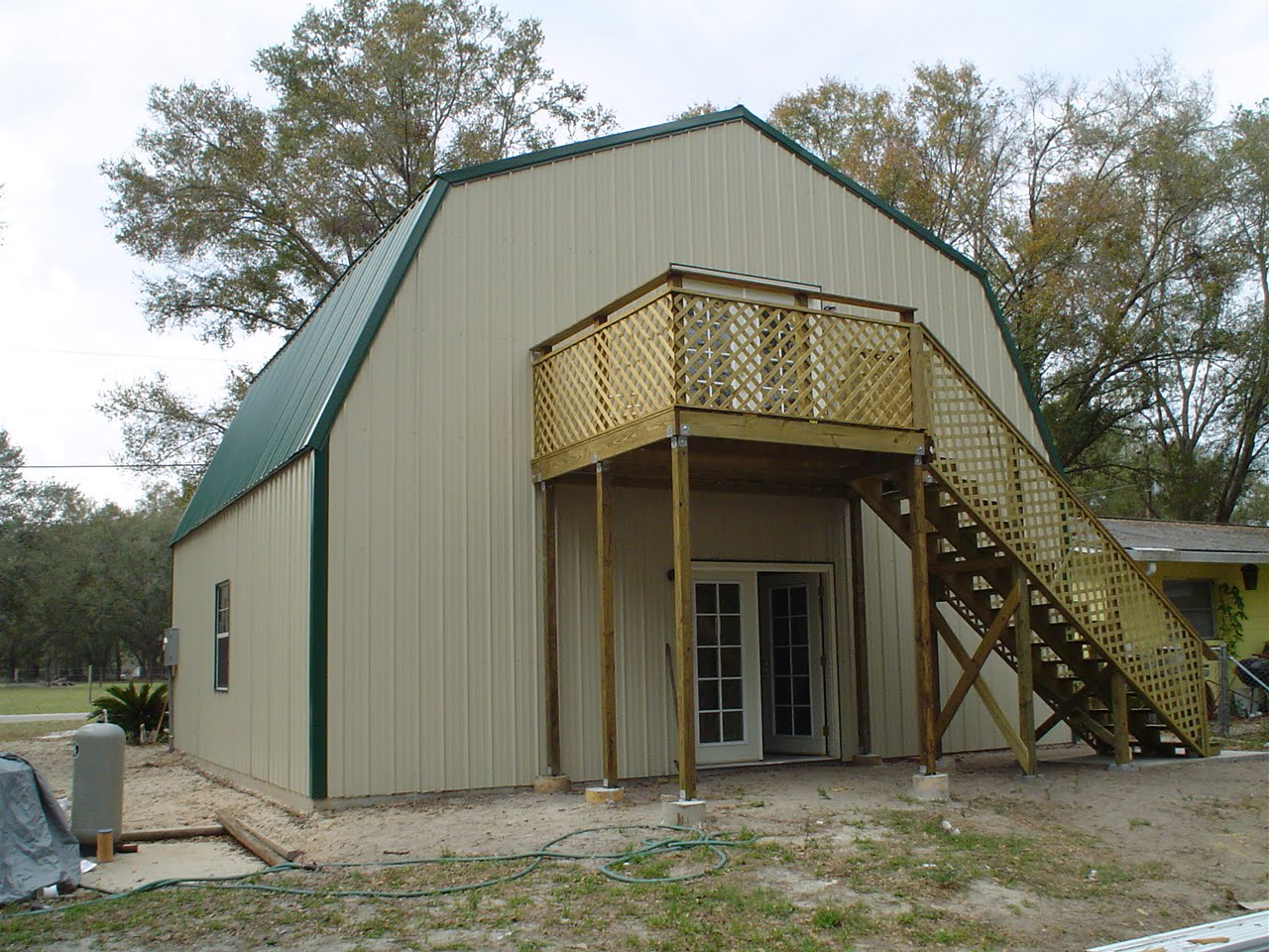 Steel frame gambrel type homes starting from 19 950 hq for Two story metal garage