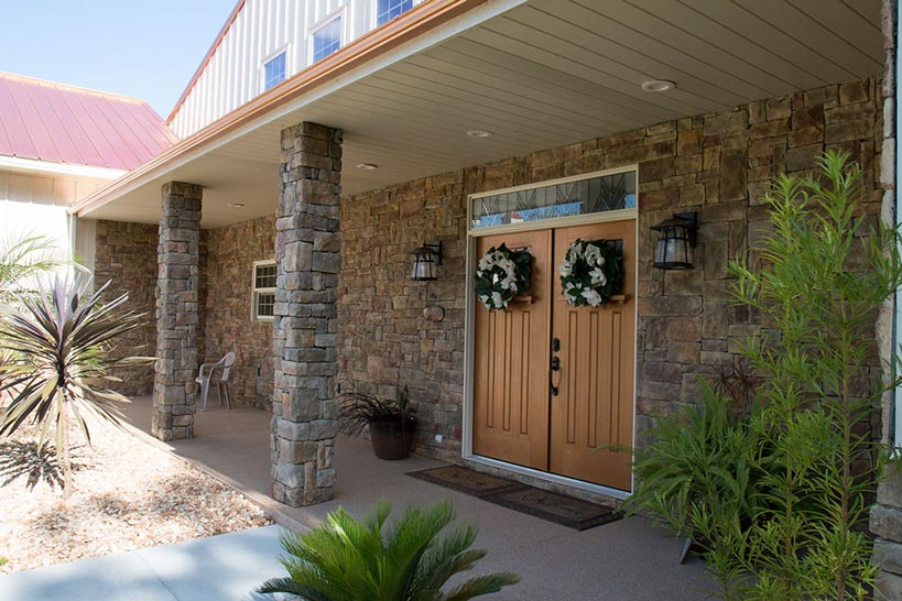 Brick pillars play out nicely with metal siding. Just look at that door - very welcoming!