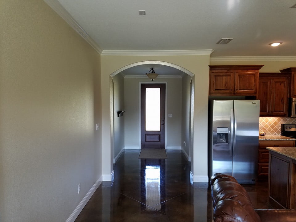 The hallway leading to the living room is very welcoming and spacious.