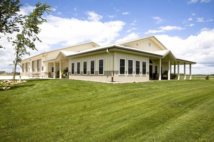 Spectacular metal building home w stone wainscot hq for Metal building shop house