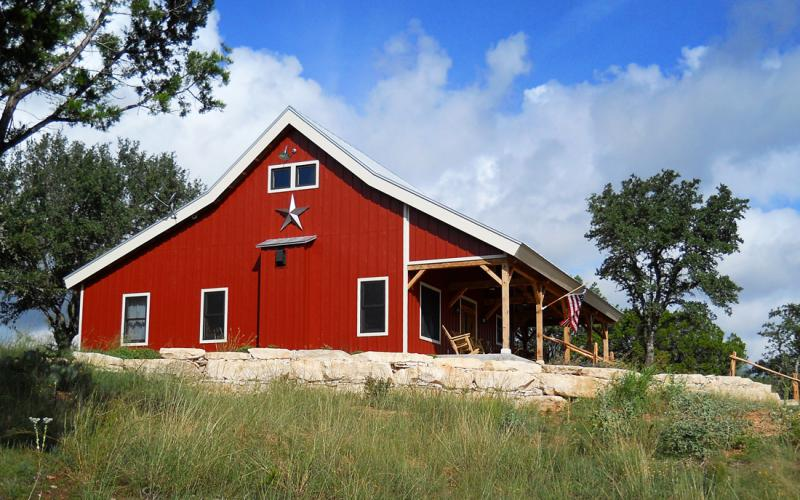 Country barn home kit w open porch 9 pictures metal for Building a house out of a pole barn