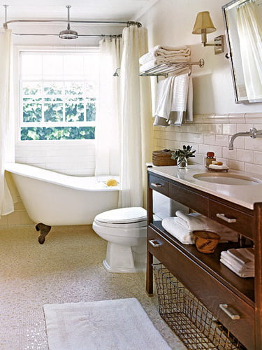 Clawfoot tub and shower in front of window